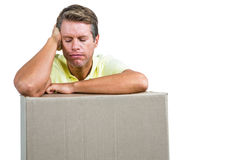Close-up of sad man with box Stock Photo