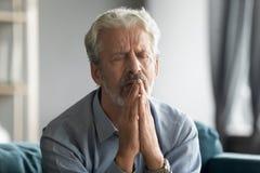 Free Close Up Sad Mature Man Praying With Hope Alone Royalty Free Stock Photo - 178961155
