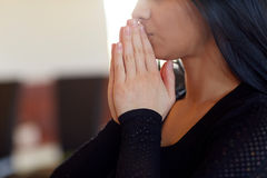 Close up of sad woman praying god in church Stock Images