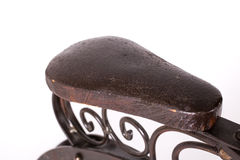 Close up on saddle of a historical bicycle. Close up on leather saddle of a historical children's bicycle on a white background Royalty Free Stock Photo