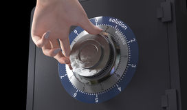 Close up of a safe lock and woman hand concept of solution and success in business