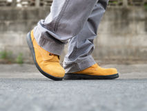 Close up of safety shoes on street Royalty Free Stock Images