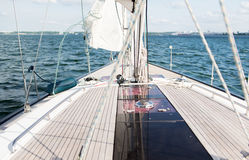 Close up of sailboat or sailing yacht deck and sea Stock Image