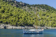 Close-up of sailing boat in the bay of assos in kefalonia. Close-up of sailing boat in the background the mountain covered with vegetation in the Bay of Assos on Stock Image