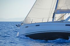 Close-up of a sailing yacht in action. Close-up of a modern sailing yacht in action. Blue waters of the Aegean sea, Greece royalty free stock photo