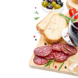 Close-up of salami, ciabatta, olives and glass of wine Royalty Free Stock Photography