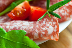 Close up of salami with fresh herbs Stock Photo