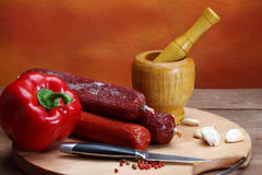 Salami sausage. Close up of salami sausage on kitchen table royalty free stock photography