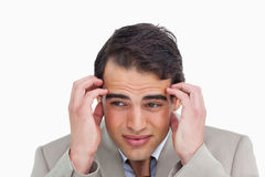 Close up of salesman having a headache Royalty Free Stock Photos