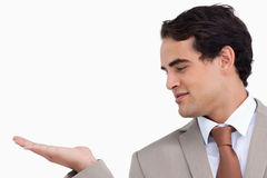 Close up of salesman looking at his palm Stock Photo