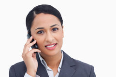 Close up of saleswoman on her cellphone Royalty Free Stock Images