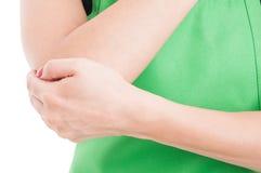 Close-up of saleswoman hurt elbow Royalty Free Stock Image
