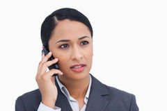 Close up of saleswoman listening to caller Stock Photos