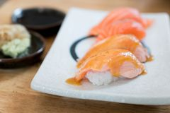 Close up salmon burned top with mayo in plate. Healthy Japanese. Nigiri Aburi Sushi style with rice and fish in Japanese food restaurant Royalty Free Stock Images