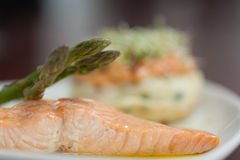 Close up of salmon dish with asparagus Stock Photography