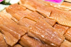 Close up of salmon fillets spread over ice on a fish monger's. Close up of salmon fillets spread over ice on a fish monger's market stall in Yorkshire Stock Photos