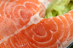 Close-up salmon steak with leaf Royalty Free Stock Images
