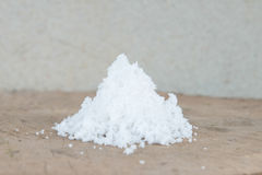 Close up salt. Many Garlic   set on timber with Cement Background Stock Photography