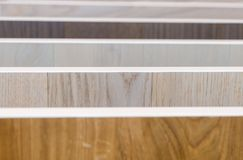 Close up of samples of various color palette for wooden floor. In the building store royalty free stock photos
