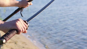 Close up of samurai sword in master's hands. Slowly stock footage