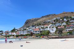 Fish Hoek Beach Sand. Close up of the sand and blue ocean at Fish Hoek Beach on a sunny day in Cape Town, South Africa Royalty Free Stock Image
