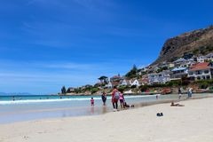 Fish Hoek Beach Sand. Close up of the sand and blue ocean at Fish Hoek Beach on a sunny day in Cape Town, South Africa Stock Photos