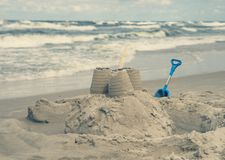 Close up on sand castle on the beach, vintage effect stock image