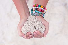 Close-up of sand heart in woman's hands Stock Photo