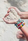 Close-up of sand heart in woman's hands Royalty Free Stock Image