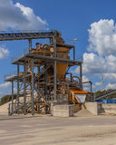 Close up of a Sand sorting machine under blue clouded sky. Industrial installation for sand sorting and washing used for concrete production and construction royalty free stock photo