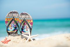 Close up sandals on the sand beach with starfish sandy beach. Royalty Free Stock Photography