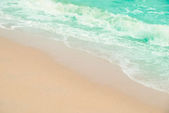 Close up sands beach and water wave sea Stock Image