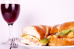 Close up of sandwich. Close up of hot sandwich and a glass of wine Royalty Free Stock Photos