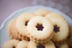 Close up, sandwich cookies filled with jam. Studio shot. Stock Photos