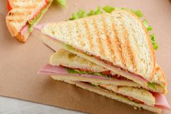 Close up on sandwich triangle. S. Grilled toast bread, lettuce, tomato, cheese and ham stock photos