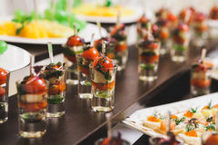Close up of sandwiches, appetizers and fruit Royalty Free Stock Image