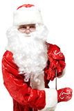 Close-up of Santa Claus with a bag of gifts. Royalty Free Stock Images