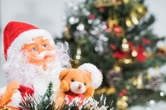 Close-up of Santa Claus and Christmas tree background. Stock Photos