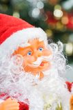 Close-up of Santa Claus and Christmas tree background. Stock Photography