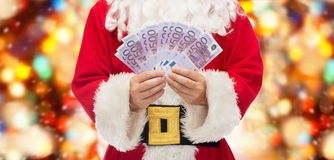 Close up of santa claus with euro money Stock Images