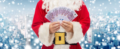 Close up of santa claus with euro money Royalty Free Stock Photo