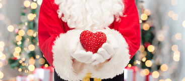 Close up of santa claus with heart shape Stock Photo