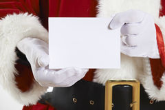 Close Up Of Santa Claus Holding Blank Invitation Stock Photo