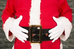 Close up on Santa Claus holding his belly. Stock Image
