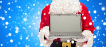 Close up of santa claus with laptop Stock Photo