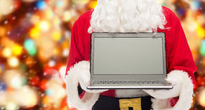 Close up of santa claus with laptop Royalty Free Stock Images