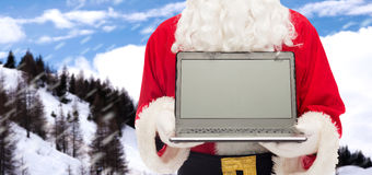 Close up of santa claus with laptop Stock Photography
