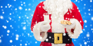 Close up of santa claus with milk and cookies Royalty Free Stock Image