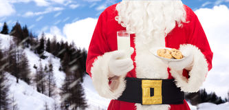 Close up of santa claus with milk and cookies Royalty Free Stock Photography