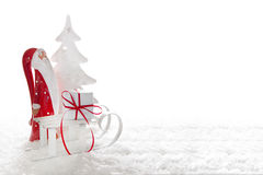 Close up of santa claus with sledge and present Royalty Free Stock Image